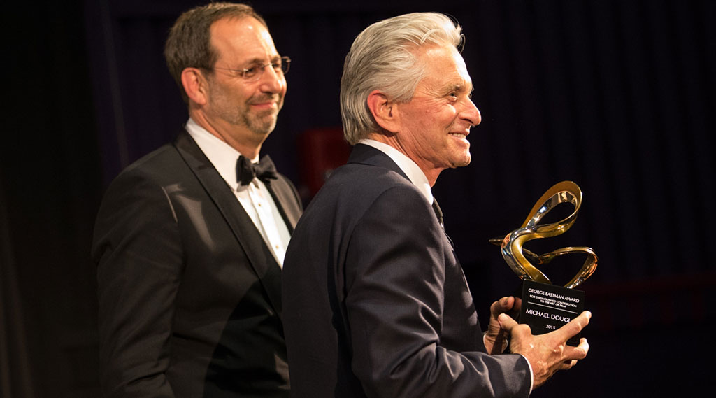 Michael Douglas holding the George Eastman Award
