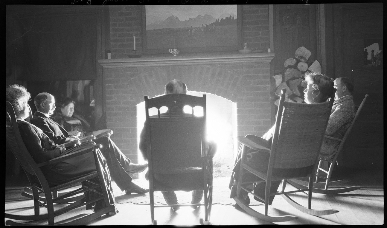 George Eastman and friends seated around fireplace