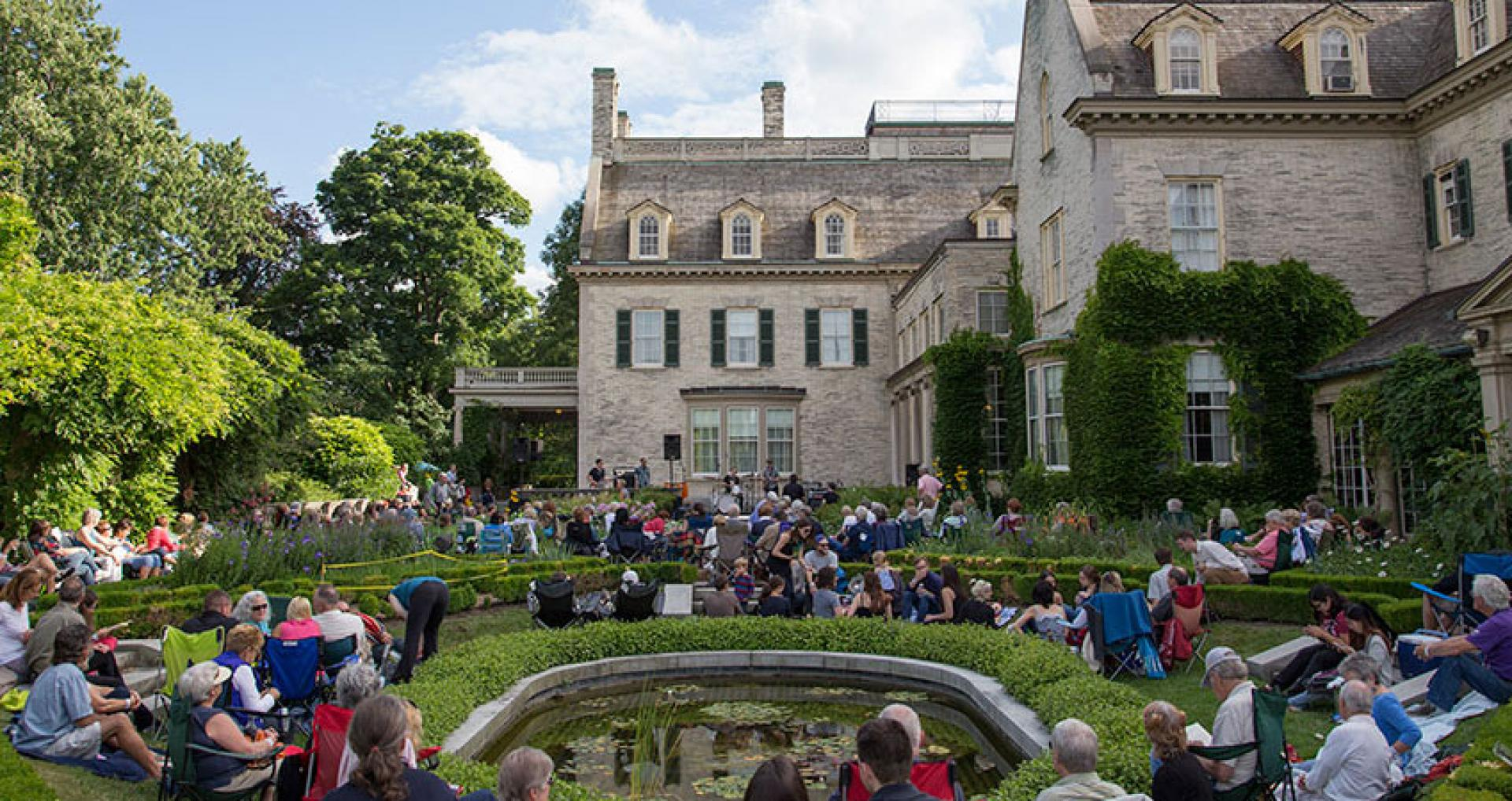 View of the mansion from the Townson Terrace garden during a garden concert