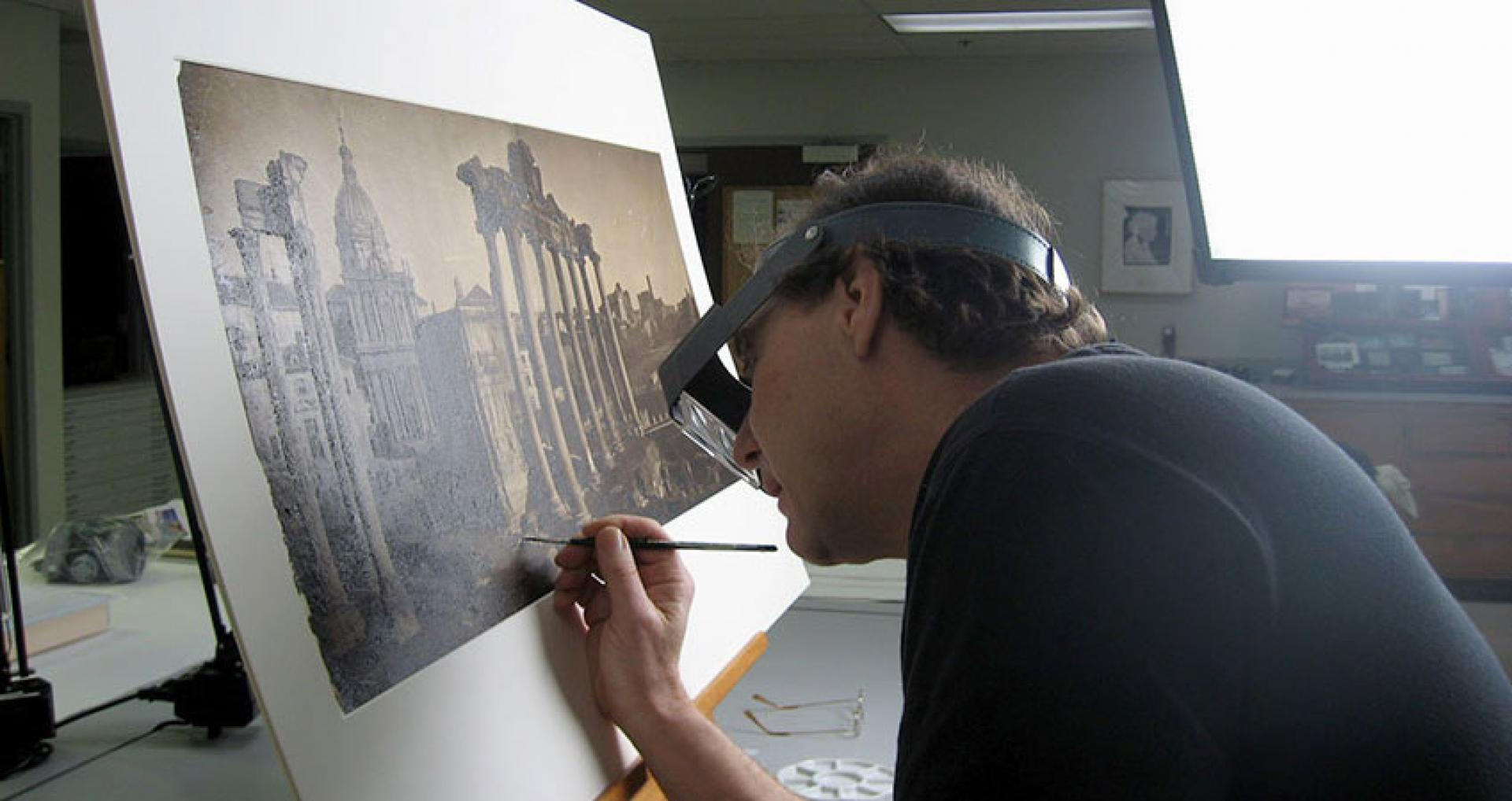 Conservator working on photograph