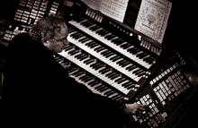Steve Kelly plays the organ