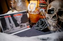 A haunted cocktail, skull and spiderwebs